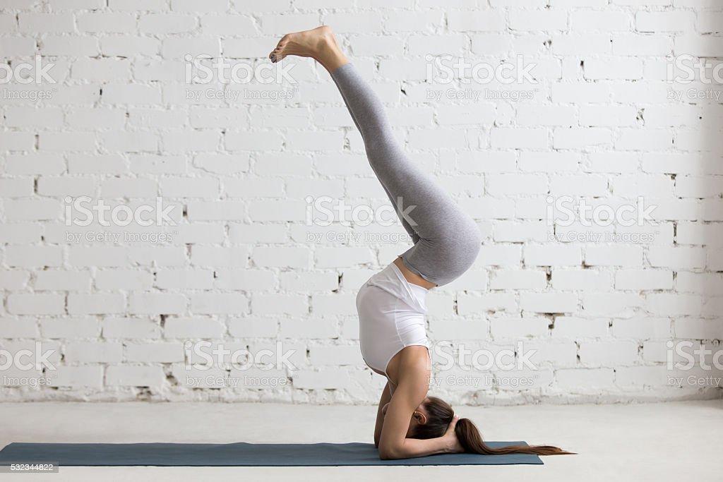 Yoga at home: variation of Salamba Sirsasana stock photo