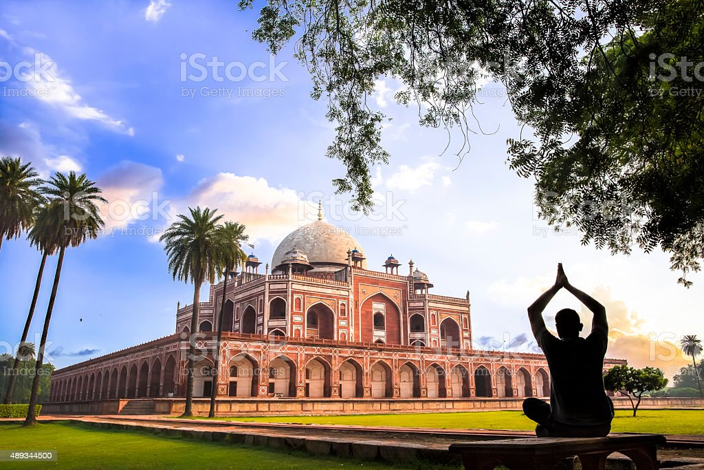 Yoga at Humayun's Tomb, Delhi, India - CNGLTRV1109 stock photo