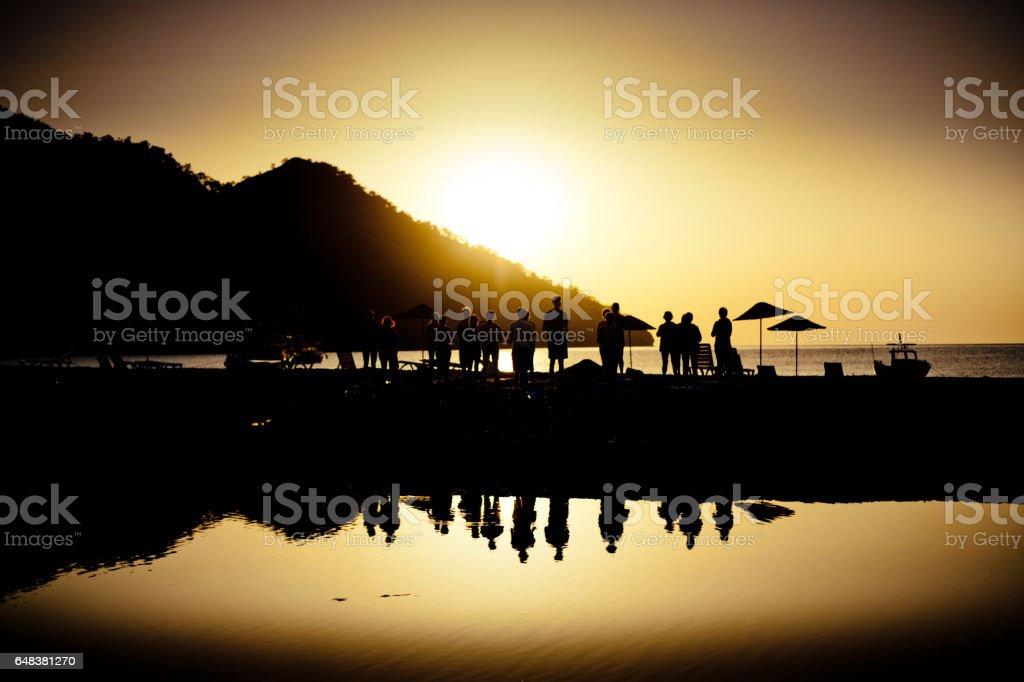 Yoga at sea cost Sunrise silhouette above sea and sky Turkey stock photo