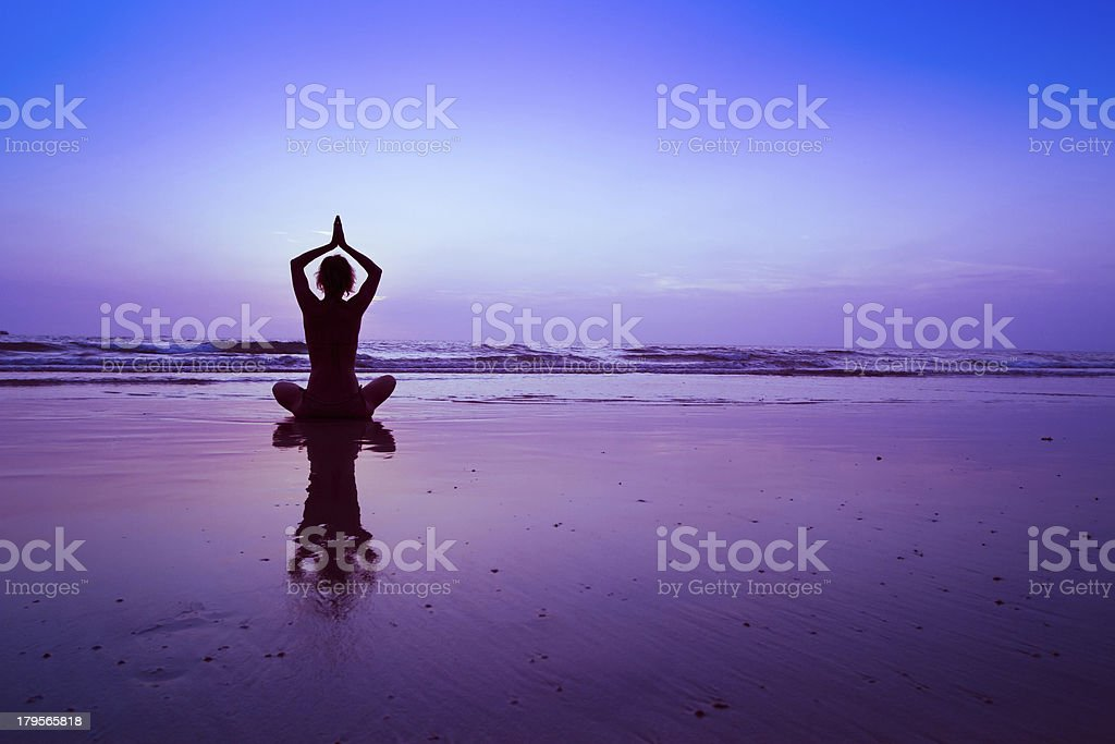 yoga at sunset stock photo