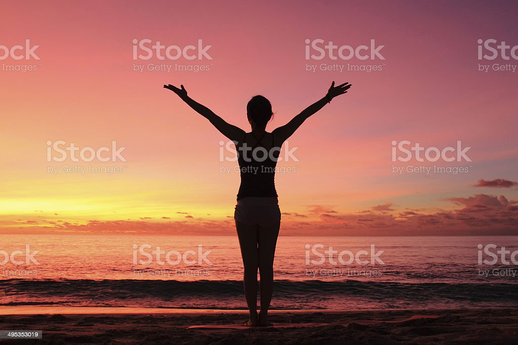 Yoga At The Beach On Sunset stock photo