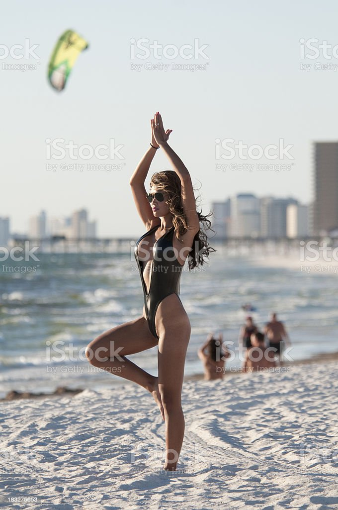 Yoga at the beach stock photo