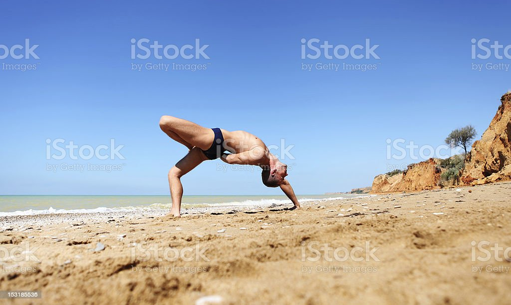 Yoga at the deserted beach stock photo