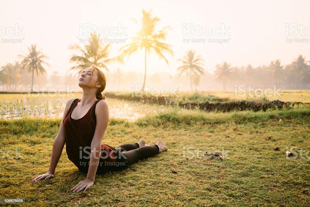 Yoga at the sunrise stock photo