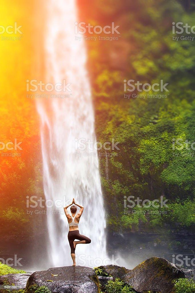 Yoga at the waterfall stock photo