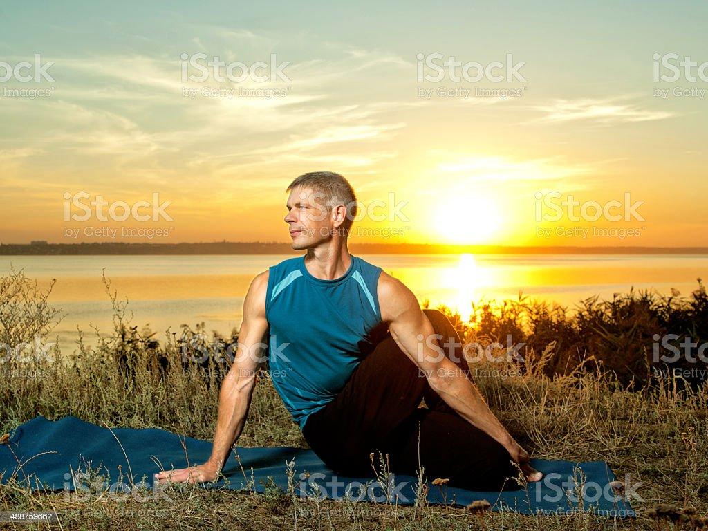 Yoga Athlete making yoga exercises outdoors stock photo