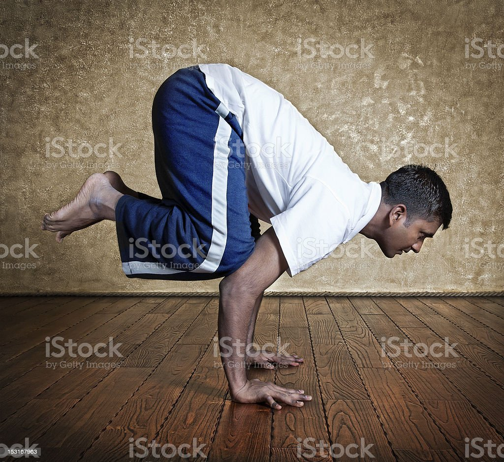 Yoga bakasana crane pose royalty-free stock photo