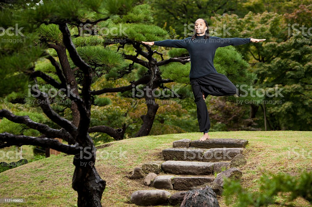 Yoga Balancing Pose in Japanese Garden stock photo