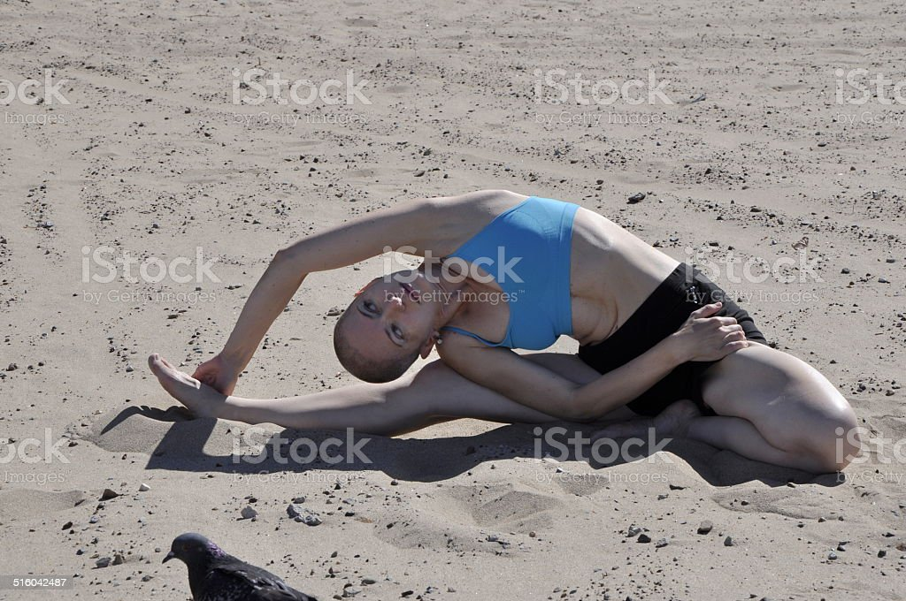Yoga beach side bend stock photo