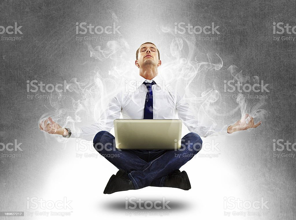 yoga businessman in total concentration with laptop stock photo