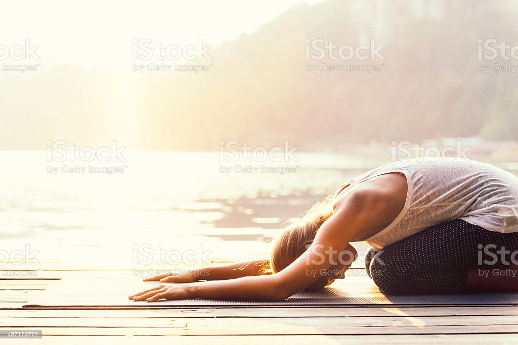 Yoga by the lake stock photo