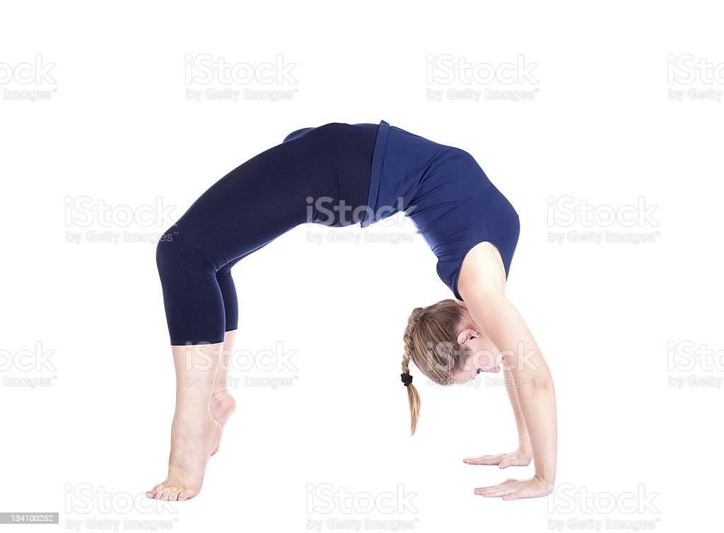 Yoga chakrasana wheel pose stock photo