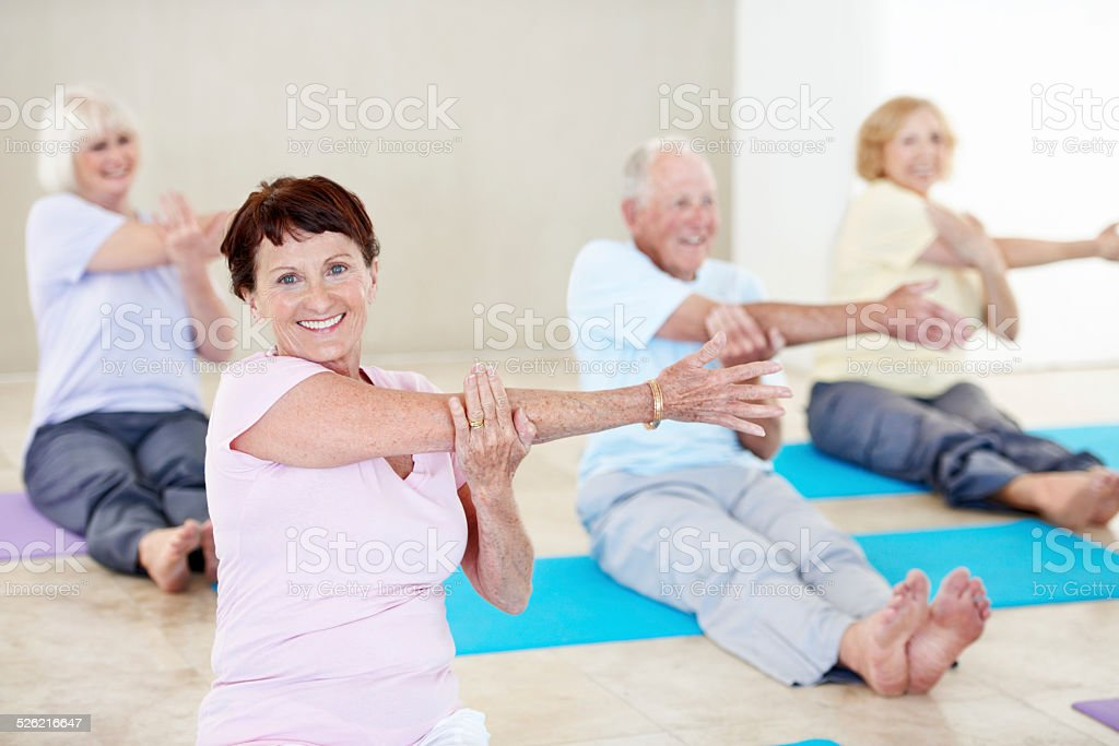 Yoga class is active and social stock photo