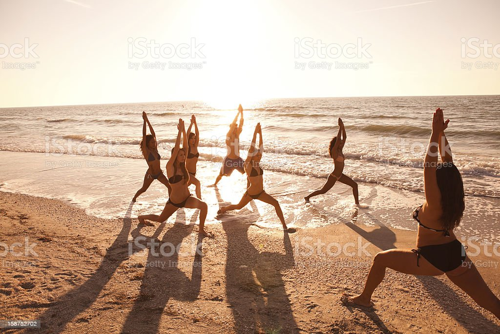Yoga class on the beach royalty-free stock photo