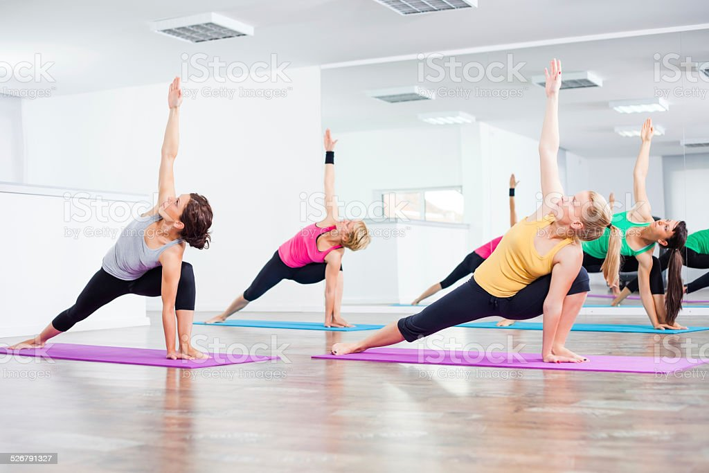 Yoga class - Trikonasana Bikram/Bikram triangle left stock photo