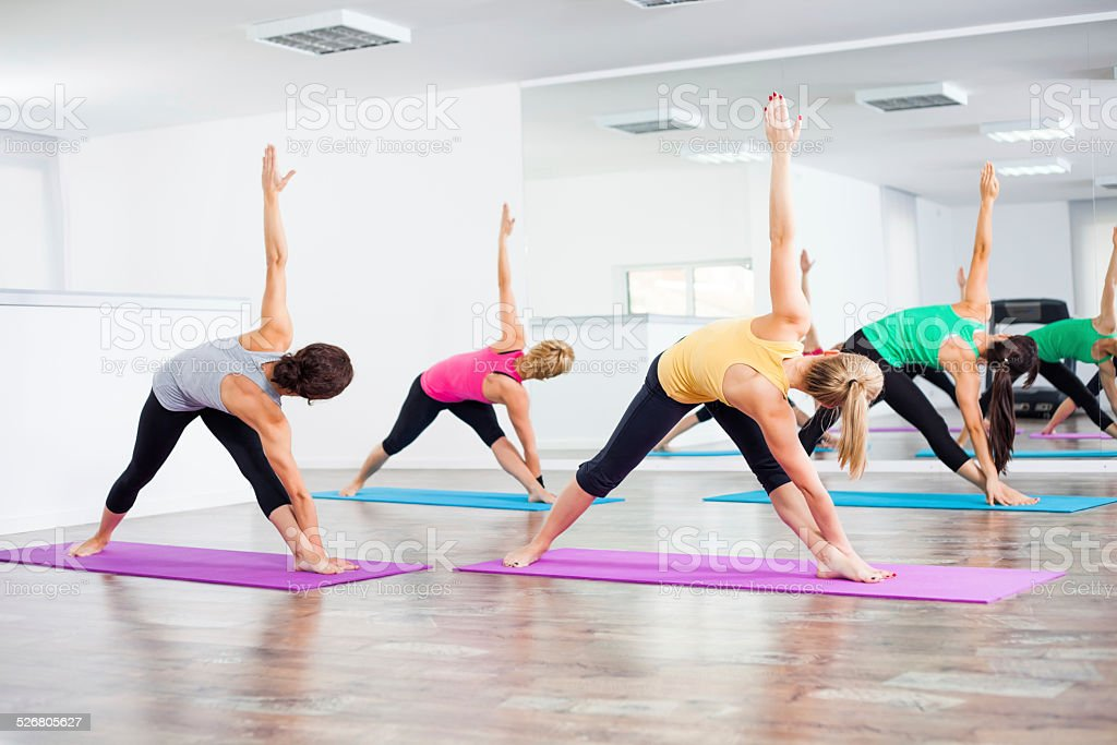 Yoga class - Trikonasana Bikram/Bikram triangle right stock photo