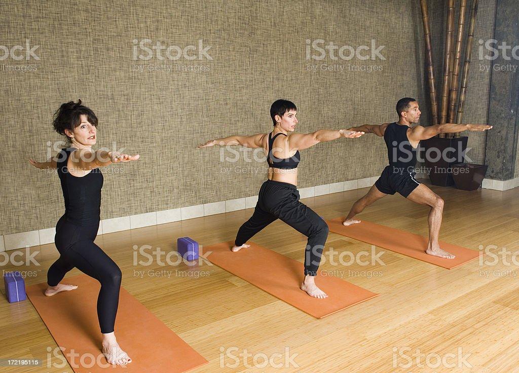 Yoga Class - Warrior Post royalty-free stock photo
