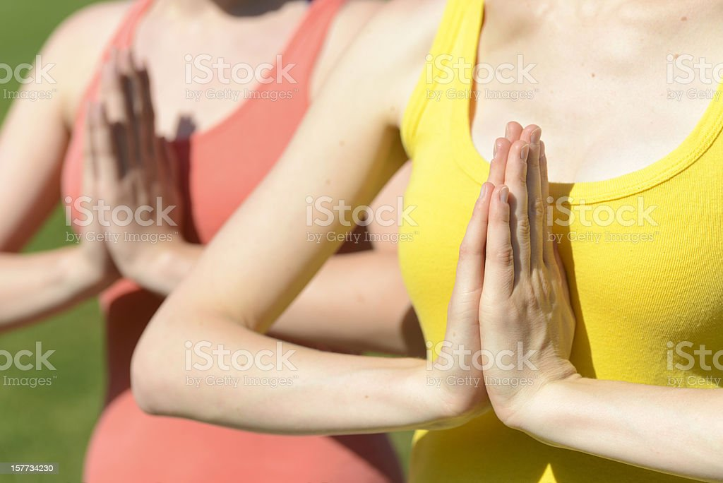 yoga close-up of two girls using hands stock photo