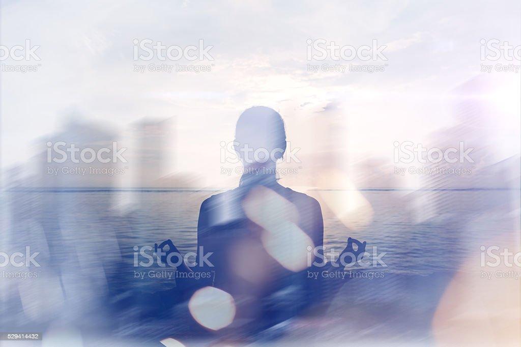 Yoga concept. Double exposure. Woman doing yoga practice stock photo