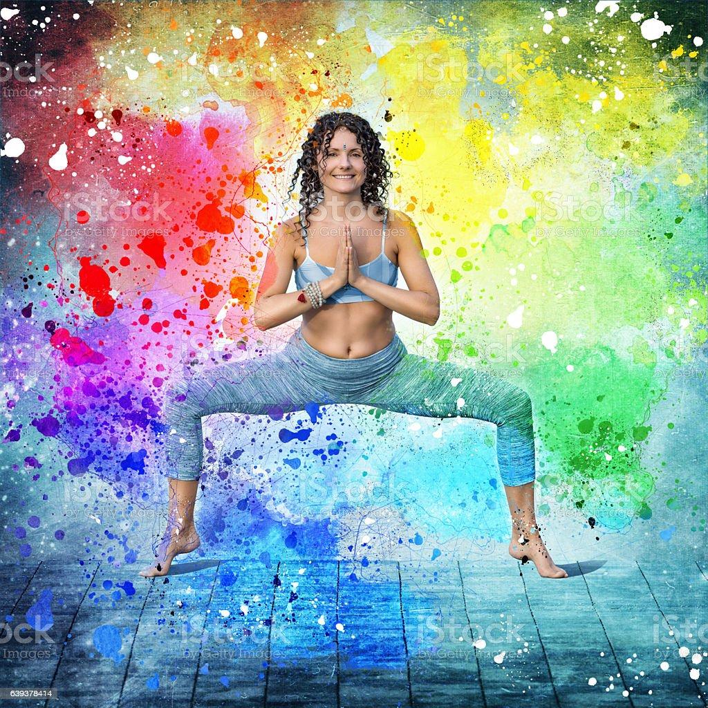 Yoga concept woman posing exercises colorful stock photo