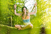 Yoga concept woman posing exercises in forest