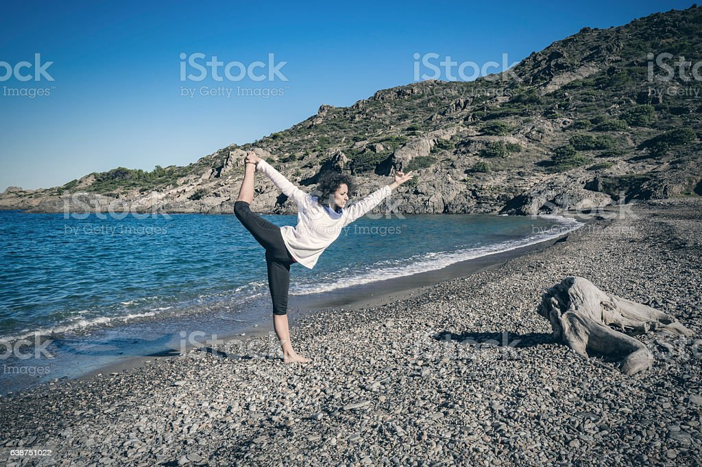 Yoga doing lord of the dance yoga pose stock photo
