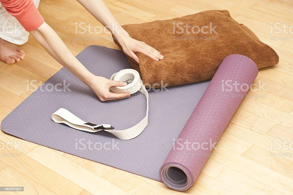 yoga equipment on wodden floor with hand stock photo