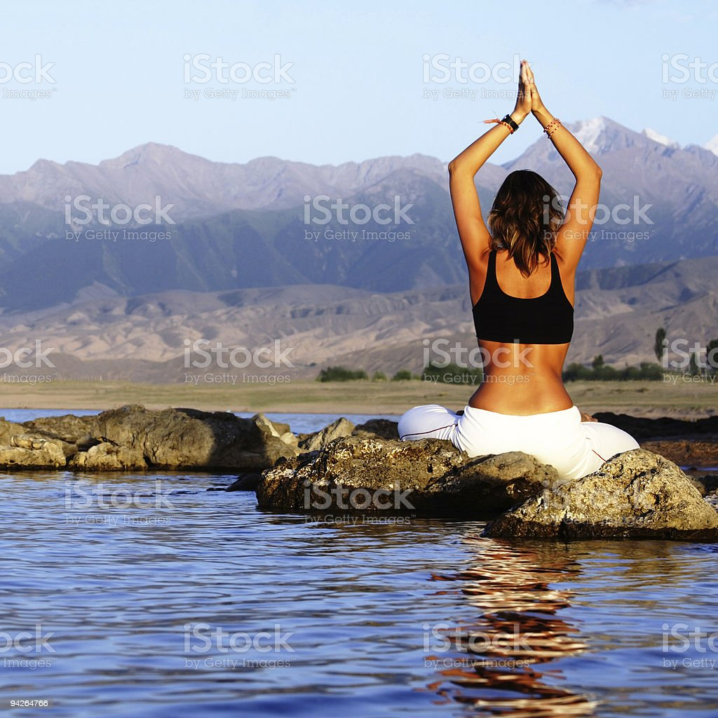 yoga exercise on beach royalty-free stock photo