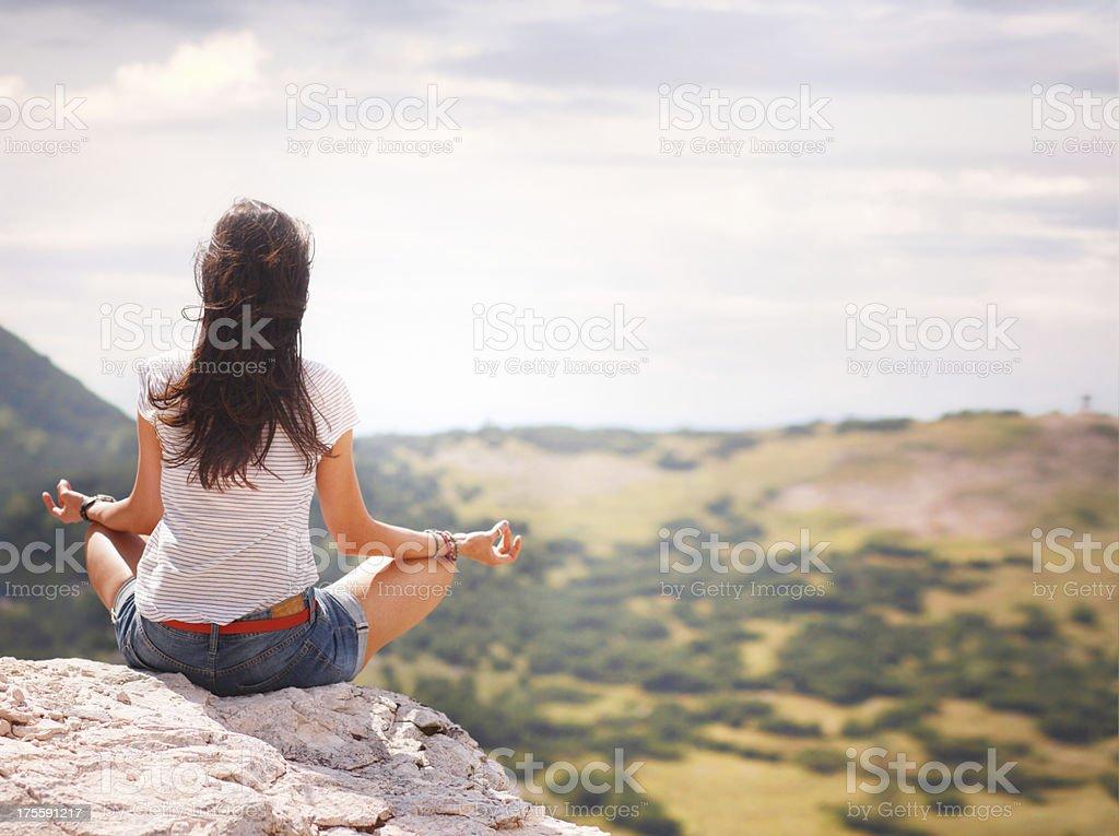 yoga exercise on the mountain top royalty-free stock photo