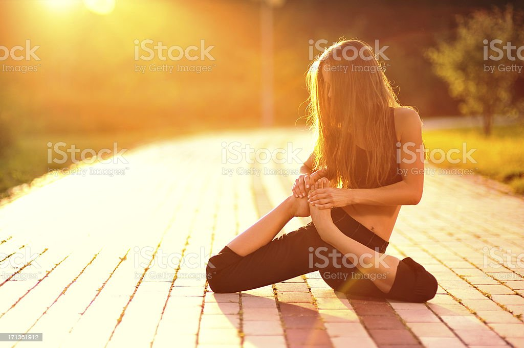 Yoga exercise (park) stock photo