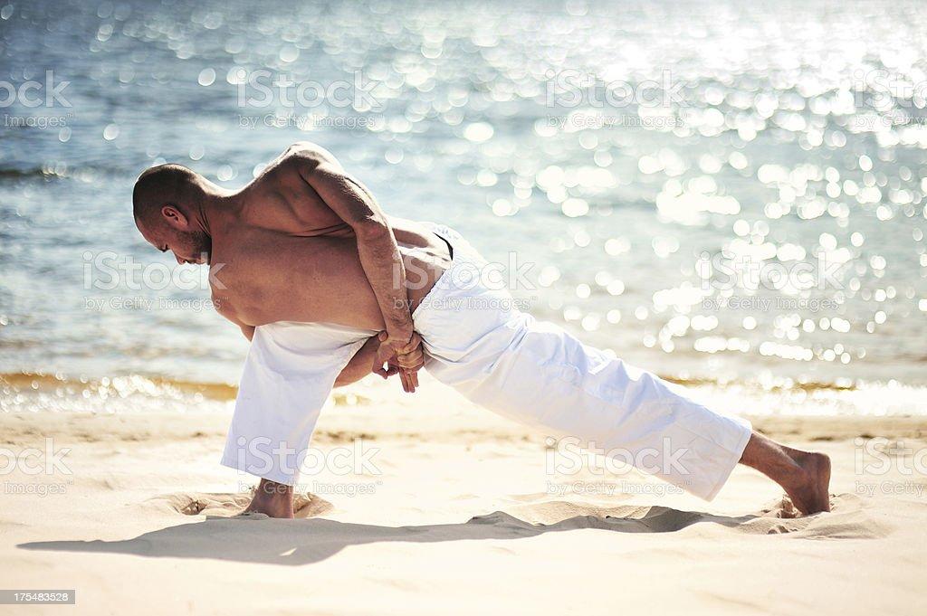 Yoga exercise (beach) stock photo