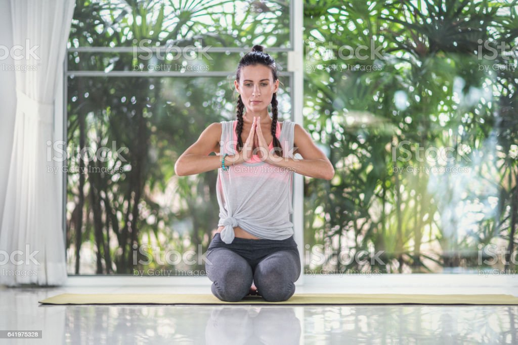 Yoga exercises at home stock photo