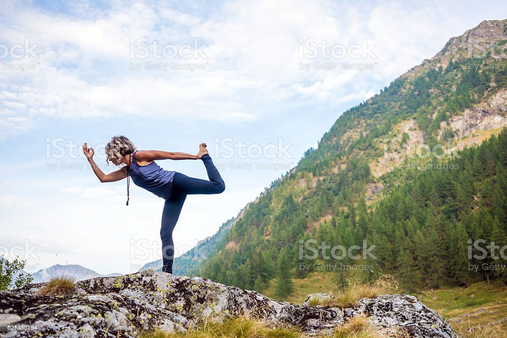 Yoga exercises in nature: Dancer pose stock photo