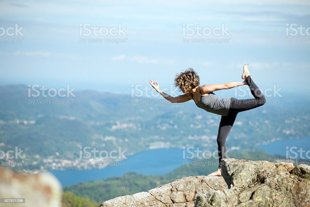 Yoga exercises in nature on mountains: Natarajasana stock photo