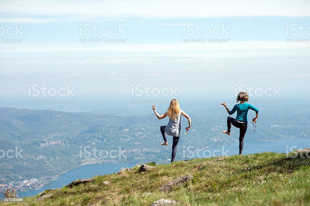 Yoga exercises in nature on mountains: Shiva dance pose stock photo