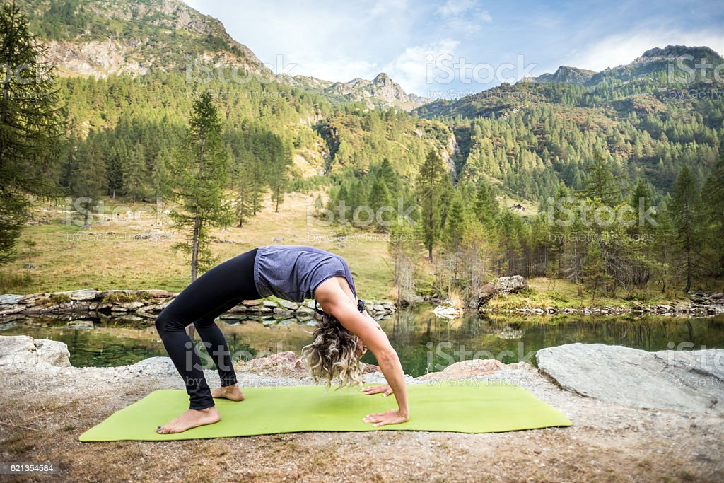 Yoga exercises in nature stock photo