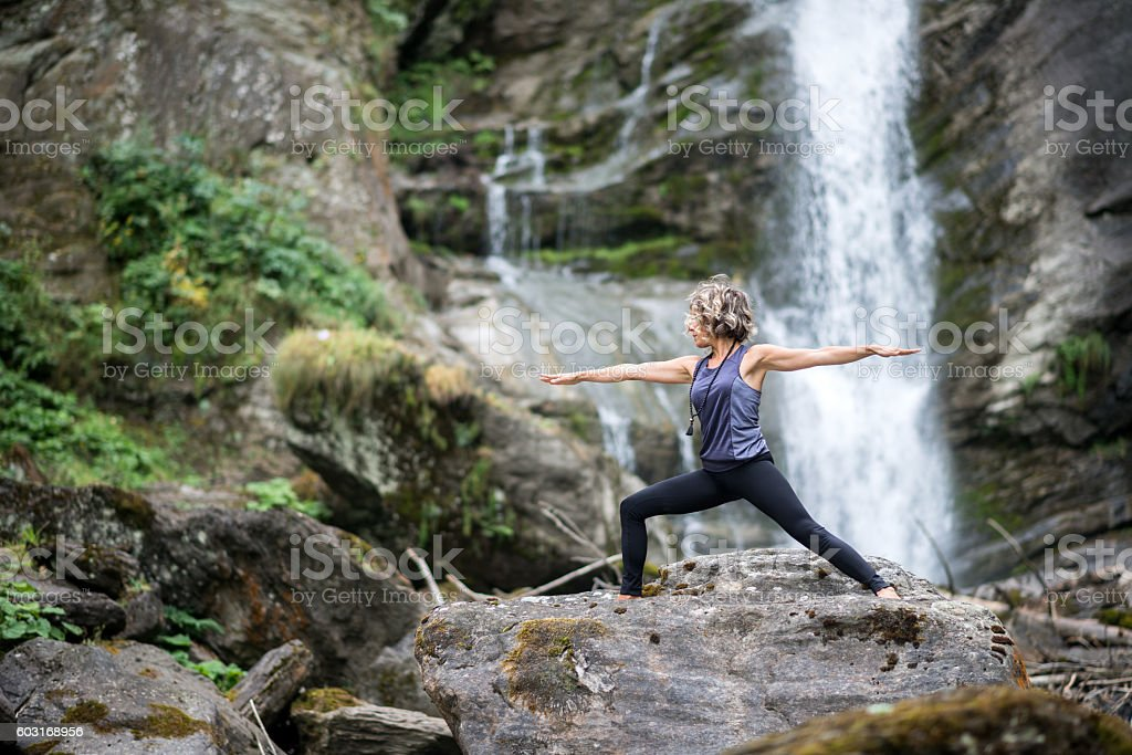 Yoga exercises in nature: Warrior 2 Pose stock photo