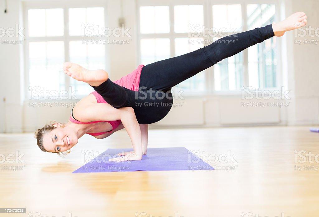 Yoga expert doing an arm balance pose royalty-free stock photo