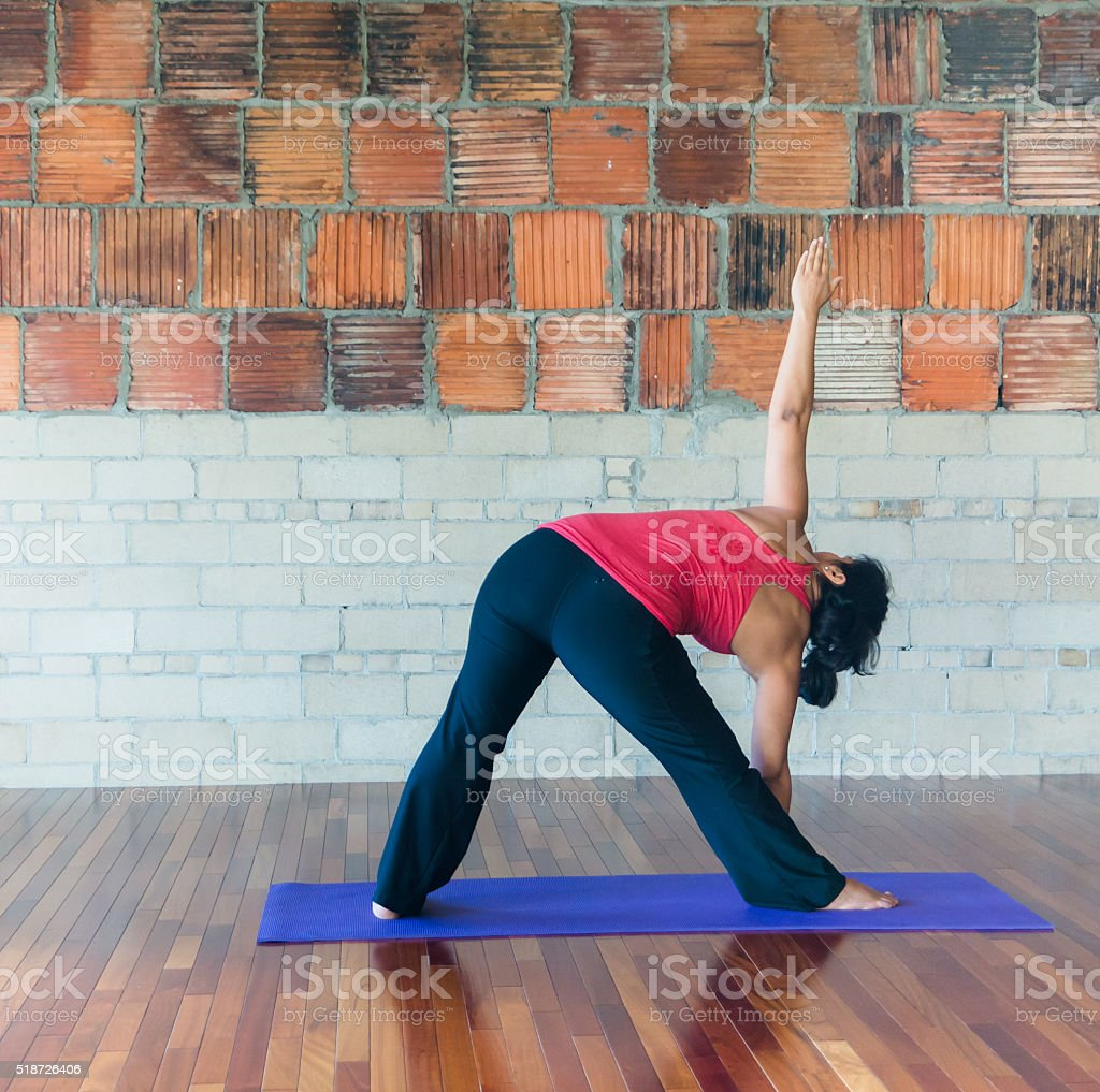 yoga extended triangle pose stock photo