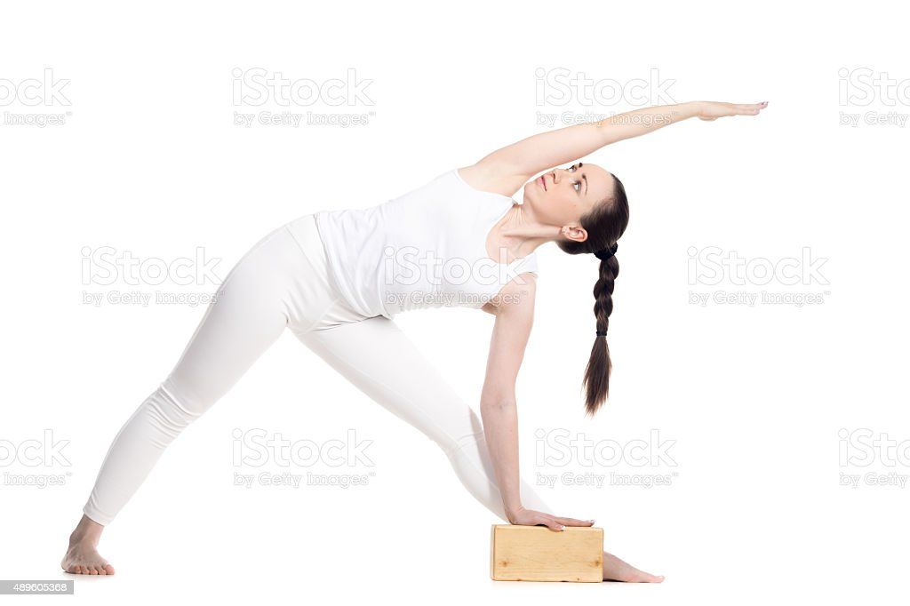 Yoga Extended Triangle Pose with props stock photo