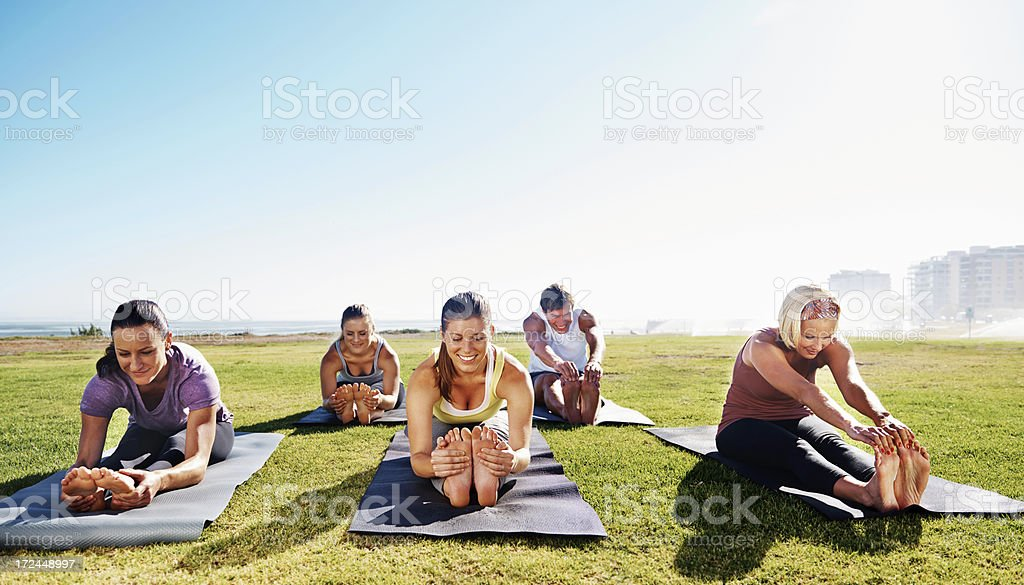 Yoga - Feeling the stretch stock photo