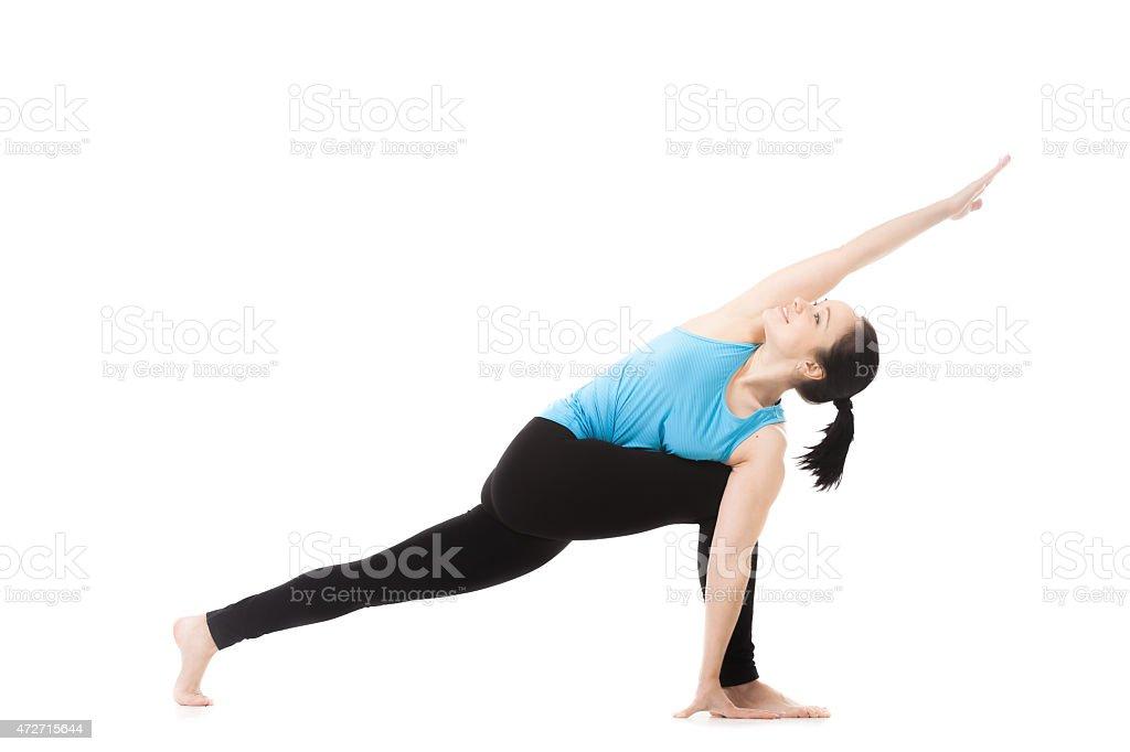 Yoga female in asana parivritta parshvakonasana stock photo