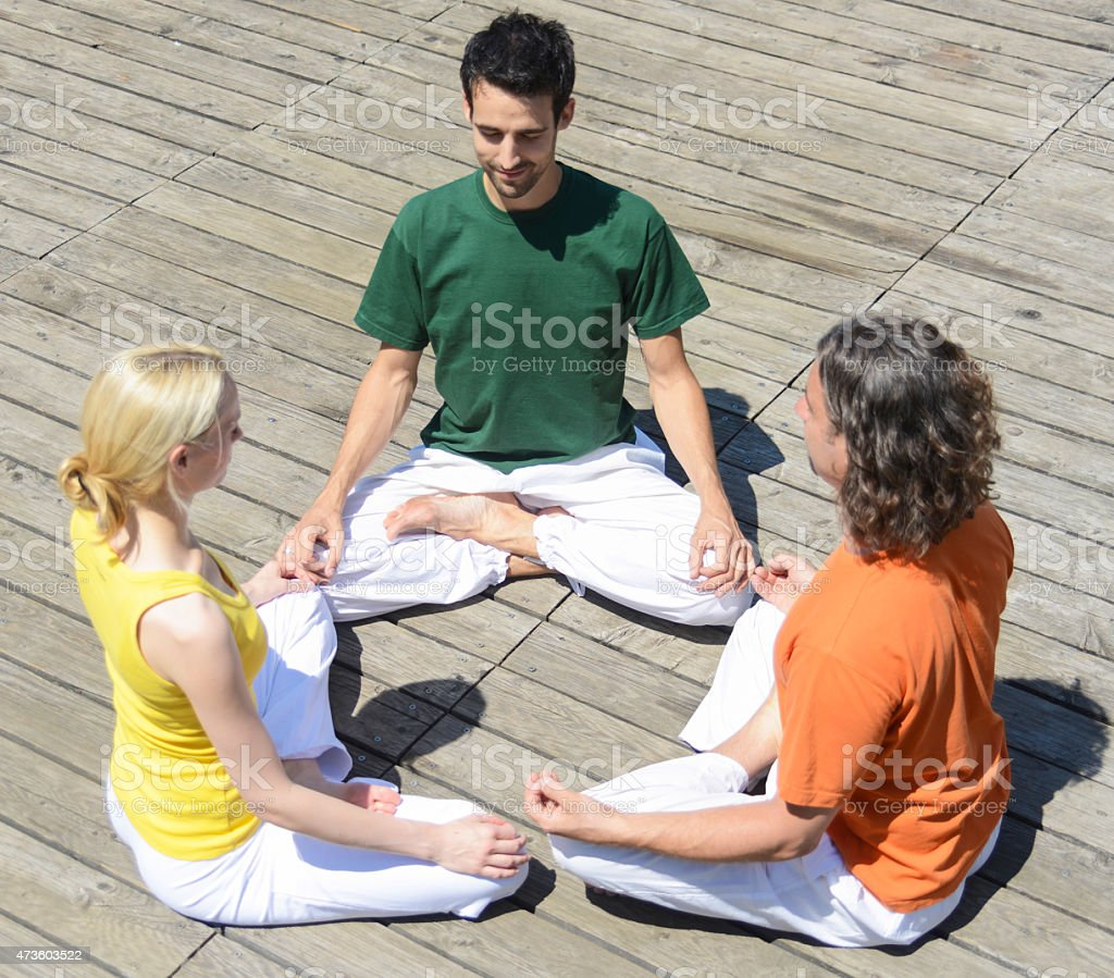 yoga group three people in circle stock photo