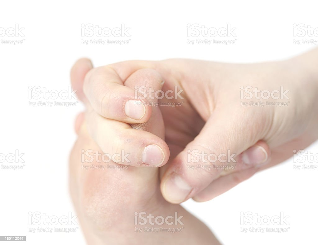 yoga - holding big toe with hand stock photo