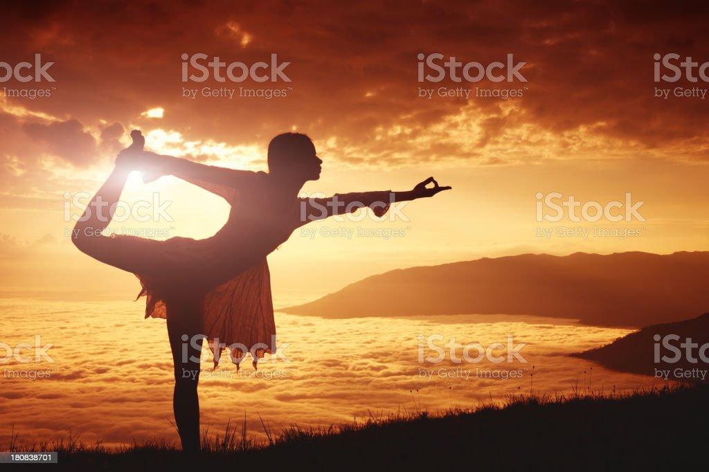 Yoga in mountains stock photo