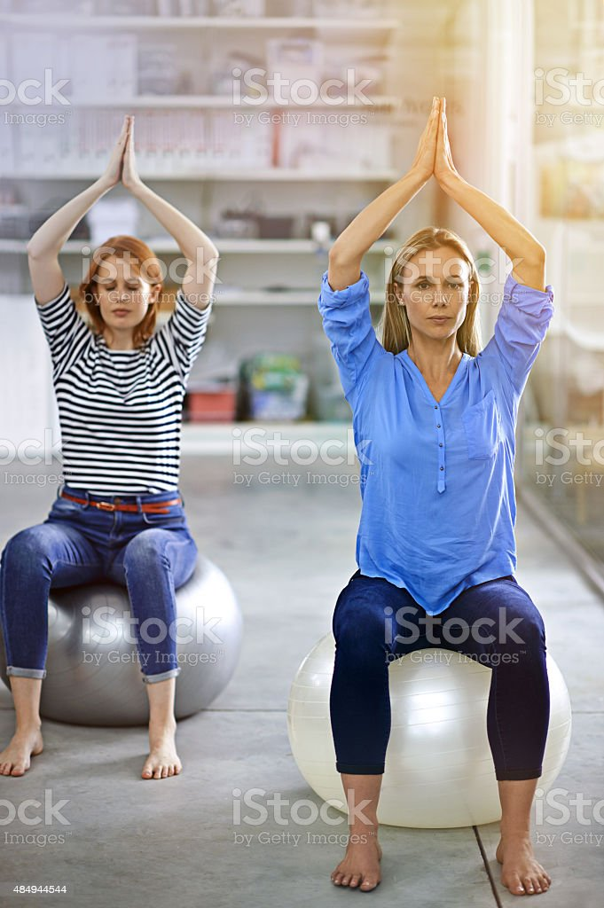 Yoga in the office stock photo