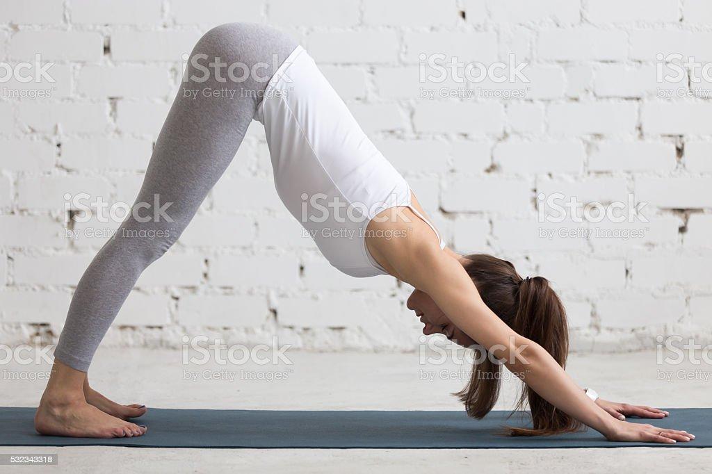 Yoga Indoors: Downward Facing Dog Pose stock photo