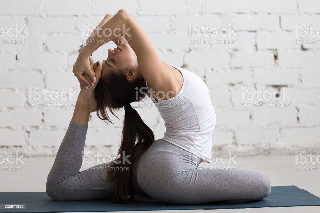 Yoga Indoors: Eka Pada Radjakapotasana stock photo