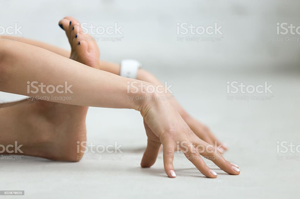 Yoga Indoors: stretching exercise stock photo