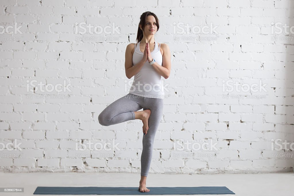 Yoga Indoors: Tree Pose stock photo
